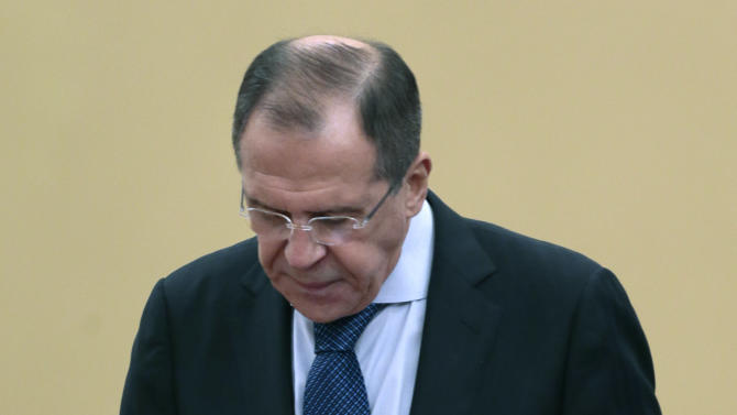 In this photo made Monday, Dec. 10, 2012, Russian Foreign Minister Sergey Lavrov walks after speaking at the International Parliamentary Forum in Moscow, Russia. Lavrov cooled  hopes for a shift in Russia's position on Syria saying Sunday that Moscow continues to strongly oppose demands for Syrian President Bashar Assad's resignation.  (AP Photo/Mikhail Metzel)