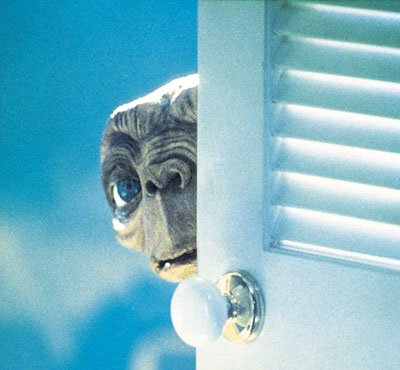 E.T. peers around the door in Universal's E.T. The Extra-Terrestrial