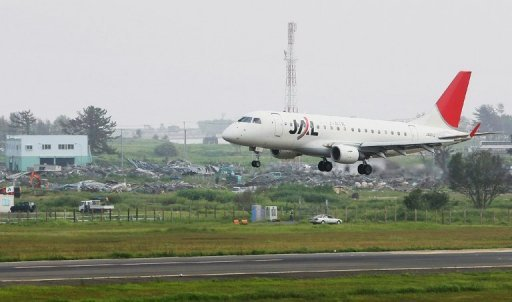<p>File photo shows a JAL passenger plane landing at Sendai airport in Natori, Miyagi prefecture. A huge unexploded World War II bomb has been found buried near the runway of one of Japan's busiest regional airports, forcing all flights to be cancelled Tuesday, officials said.</p>