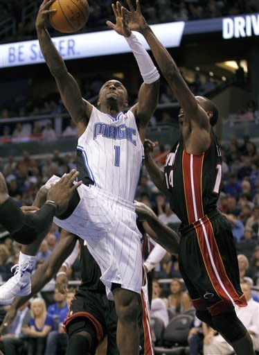 Magic slip by Heat 104-100 in preseason finale