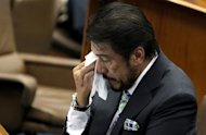 "Senate President Juan Ponce Enrile and Senator Ramon 'Bong' Revilla Jr. console Majority Floor Leader Vicente 'Tito' Sotto III after he became emotional while delivering his Turno en Contra on the Reproductive Health (RH) bill during session, Monday, August 13, 2012. Sotto was in tears as he told the story of his first-born son who died five months after birth. (Joseph Vidal, Senate Pool, NPPA Images)<br><br><a target=""_blank"" href=""http://ph.news.yahoo.com/sen--vicente-c--sotto-iii-turno-en-contra-sb-2865.html"">Full speech here: Turno en Contra SB 2865</a>"