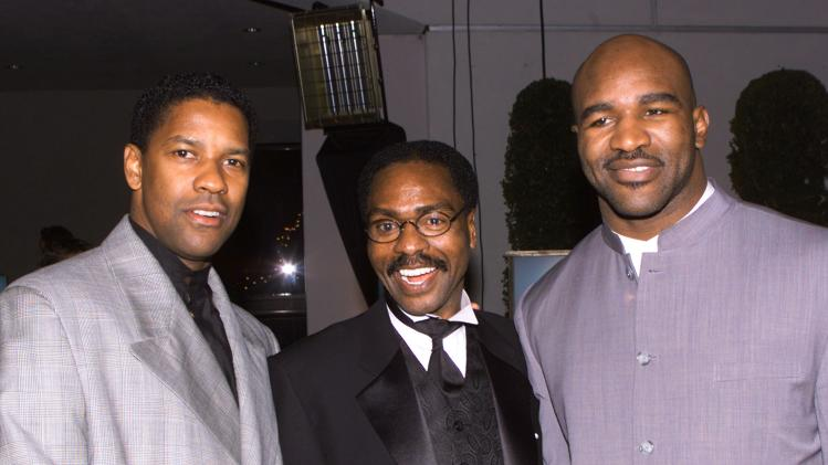 File photo of Rubin Carter posing with Washington and Holyfield at premiere of The Hurricane in Los Angeles