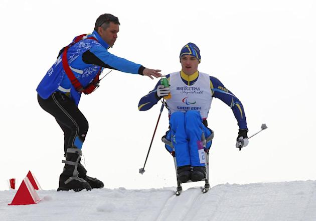 Maksym Yarovyi of Ukraine races during the 15km men's cross country ski, sitting event at the 2014 Winter Paralympic, Sunday, March 9, 2014, in Krasnaya Polyana, Russia