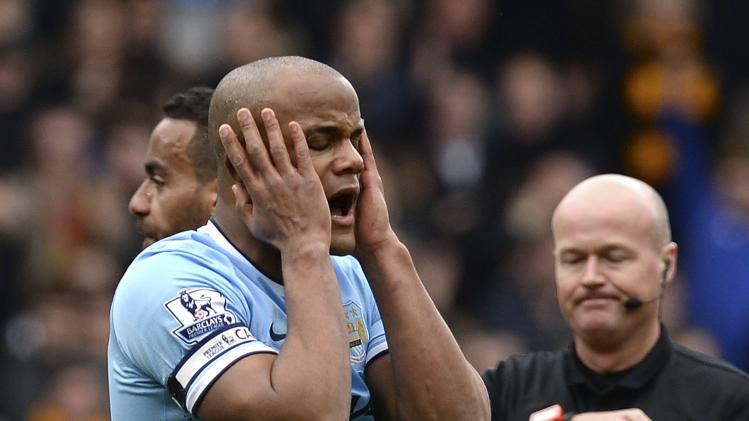 Manchester City's Vincent Kompany reacts after being sent off by referee Lee Mason during their English Premier League soccer match against Hull City in Hull