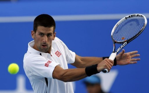 World number one Novak Djokovic of Serbia returns the ball to Spain's David Ferrer during their Mubadala World Tennis Championship exhibition match in the Emirati capital, Abu Dhabi, on December 28, 2012. Djokovic opened his season with an impressive 6-0, 6-3 win