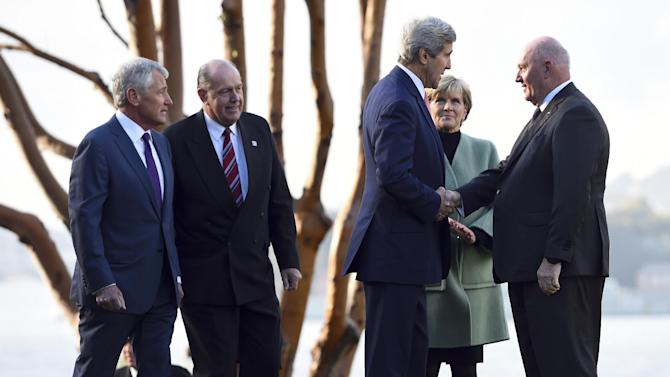 U.S. Secretary of State John Kerry, third from right, along with U.S. Secretary of Defense Chuck Hagel, left, Australian Defense Minister David Johnston, second from left, and Australian Foreign Minister Julie Bishop, is greeted by Governor-General Peter Cosgrove at Admiralty House in Sydney, Tuesday, Aug. 12, 2014. Kerry and Hagel are meeting with their Australian counterparts at the annual Australia-U.S. Ministerial Consultations (AUSMIN), which will focus on regional security and enhanced military co-operation. (AP Photo/Dan Himbrechts, Pool)