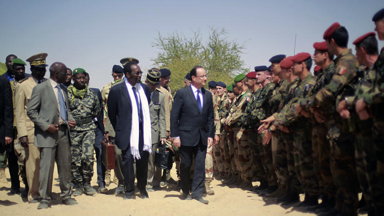 French President Francois Hollande addresses the troops at the airport following his visit to Timbuktu, Mali, Saturday Feb. 2, 2013. Hollande indicated Friday that during his visit to the former French colony, he would discuss the reduction of French troop levels on the ground to make way for an African force, led by Mali. (AP Photo/Jerome Delay)