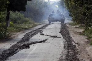 A Ukrainian tank moves along a road near Eastern Ukrainian …