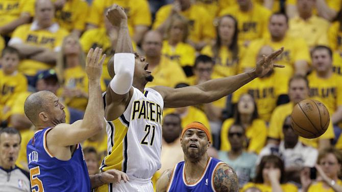 Indiana Pacers' David West (21) has the ball knocked away by New York Knicks' Jason Kidd (5) and Kenyon Martin (3) during the first half of Game 6 of an Eastern Conference semifinal NBA basketball playoff series Saturday, May 18, 2013, in Indianapolis. (AP Photo/Darron Cummings)