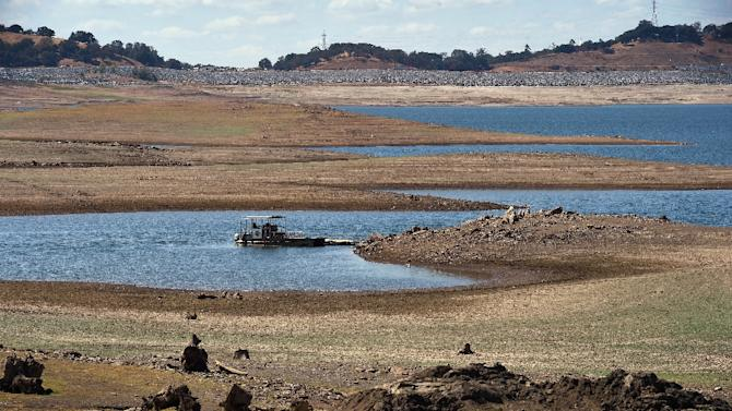 A boat floats in Folsom Lake reservoir near Sacramento, standing at only 18 percent capacity, as the severe drought continues in California on September 17, 2015