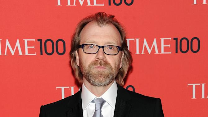 """FILE - This April 23, 2013 file photo shows writer George Saunders at the TIME 100 Gala celebrating the """"100 Most Influential People in the World"""" in New York. Saunders was named a National Book Awards finalist for fiction on Thursday, Sept. 19. (Photo by Evan Agostini/Invision/AP, File)"""