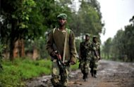 <p>M23 rebels patrol in Rangira, near Rutshuru, in the Democratic Republic of Congo in October. The UN Security Council demanded an end to foreign support for rebels closing on a provincial capital in eastern Democratic Republic of Congo.</p>