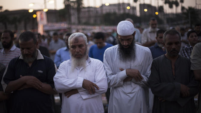 Supporters of Egypt's ousted President Mohammed Morsi pray during a protest near Cairo University in Giza, Egypt, Sunday, July 28, 2013. Setting the stage for more confrontation, the military-installed interim president, Adly Mansour, gave Prime Minister Hazem el-Biblawi the power to grant the military the right to arrest civilians in what government officials said could be a prelude to a major crackdown on Morsi's supporters or Islamic militants who have stepped up attacks against security forces in the Sinai Peninsula. (AP Photo/Manu Brabo)
