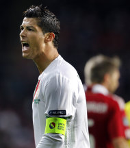 Portugal's Ronaldo reacts during the game against Denmark during their Euro 2012, group H, qualifying soccer match at Parken Stadium, Copenhagen, on Tuesday, Oct. 11, 2011. Denmark defeated Portugal 2-1. (AP Photo/POLFOTO, Lars Poulsen) DENMARK OUT