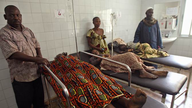 Injured people are seen at a hospital with their family members standing with them, after they were involved in a  stampeded in Abidjan, Ivory Coast, Tuesday, Jan. 1, 2013. At least 61 people were killed early Tuesday in a stampede following a New Year's fireworks display in Abidjan, Ivory Coast's commercial center, said officials. The death toll is expected to rise, according to rescue workers. The majority of those killed were young people between eight and 15 years old who were trampled after the fireworks festivities in Abidjan's Plateau district, at about 1 a.m. Tuesday, said Col. Issa Sako, of the fire department rescue team. (AP Photo/Emanuel Ekra)