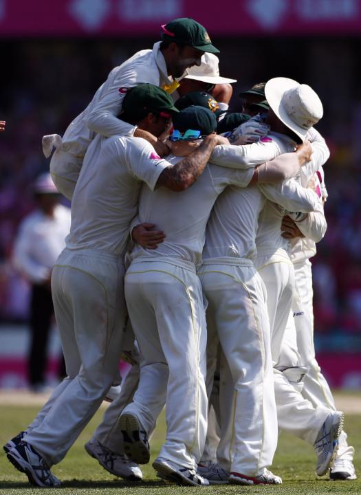 Australia's players celebrate after winning the fifth Ashes cricket test against England at the Sydney Cricket Ground