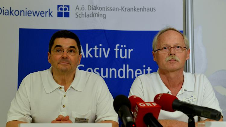 Dr. Christian Kaulfersch, left,  and Dr. Harald Simader  of the hospital Schladming speak to media after US  Lindsey  Vonn crashed during the women's super-G at the Alpine skiing world championships in Schladming, Austria, and was flown to this hospital, Tuesday, Feb. 5, 2013. (AP Photo/Kerstin Joensson)