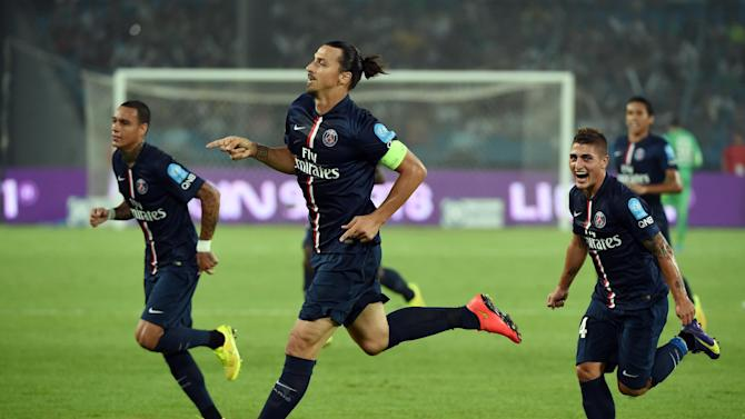 PSG's Zlatan Ibrahimovic (C) celebrates after scoring during a Champions Trophy match against Guingamp in Beijing on August 2, 2014