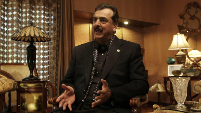 Pakistani Prime Minister Yousuf Raza Gilani gestures during an interview with The Associated Press at his residence in Lahore, Pakistan, Monday, Dec. 5, 2011. Gilani says his country wants to rebuild ties with the United States despite Islamabad's ongoing retaliation for deadly airstrikes on its troops by the U.S.-led coalition in Afghanistan. (AP Photo/Muhammed Muheisen)