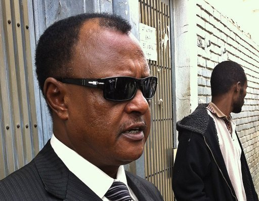 "<p>Ethiopian lawyer Abebe Guta -- who represented the 24 people on trial for terrorism offences -- talks to reporters outside the Addis Ababa courthouse on June 27. An Ethiopian court has jailed a journalist for 18 years for ""terrorism"" and 23 others for between eight years and life, after a trial condemned by rights groups.</p>"