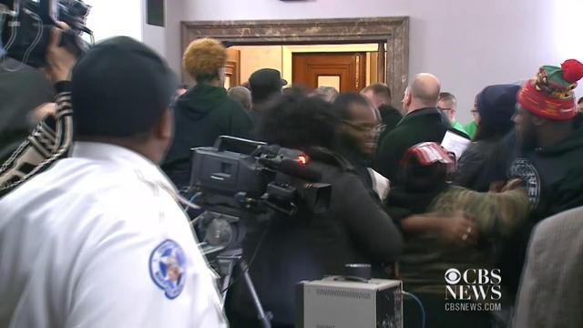 Near-brawl breaks out at city council meeting to heal wounds between police and public after Ferguson unrest
