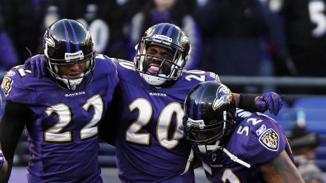 Baltimore Ravens free safety Ed Reed, center, is helped off the field by teammates defensive back Jimmy Smith, left, and inside linebacker Ray Lewis, right, during the second half of an NFL divisional playoff football game against the Houston Texans in Baltimore, Sunday, Jan. 15, 2012. The Ravens defeated the Texans 20-13. (AP Photo/Evan Vucci)