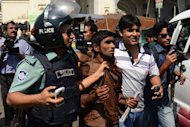 Bangladeshi police detain a suspected Jamaat-e-Islami activist in front of the Baitul Mukarram, the national mosque in Dhaka on March 1, 2013. The number of people killed in clashes in Bangladesh over the conviction of Islamist leaders for war crimes rose to 53 on Friday as fresh violence erupted in the Muslim-majority nation