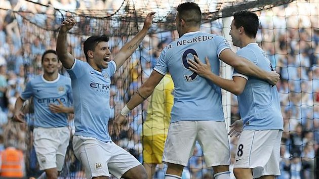 Sergio Aguero celebrates after scoring in the Manchester derby (Reuters)