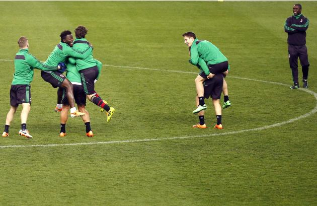 AC Milan's players take part in a training session at the Vicente Calderon stadium in Madrid