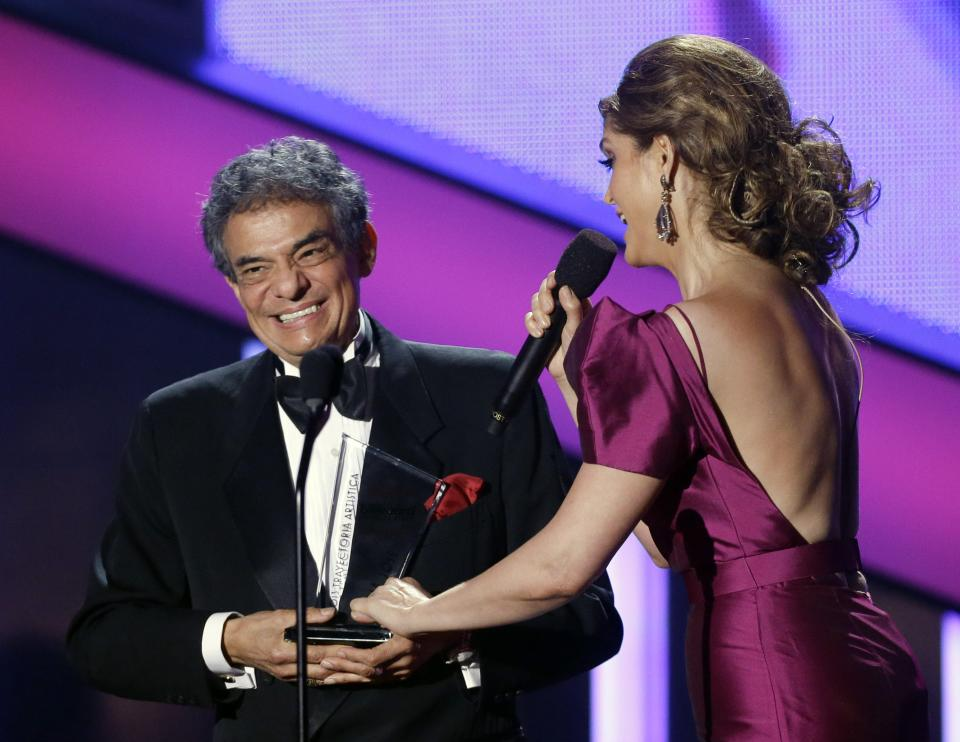 Host Ana Barbara serenades singer Jose Jose at the Latin Billboard Awards in Coral Gables, Fla., Thursday April 25, 2013. Jose Jose was presented with the Billboard Lifetime Achievement Award. (AP Photo/Alan Diaz)