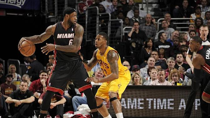 Back in Cleveland, LeBron won't discuss future