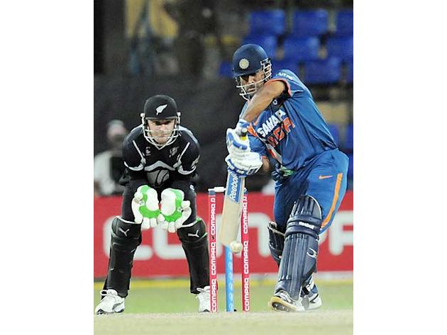 Mahendra Singh Dhoni (R) plays a stroke as Brendon McCullum looks on during the second match of the Compaq Cup between India and New Zealand at The R Premadasa Stadium in Colombo. (Lakruwan Wanniarach