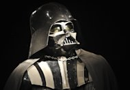 FILE - In this Oct. 27, 2010 file photo, a Darth Vader costume produced for the second Star Wars movie &quot;The Empire Strikes Back,&quot; released in 1980, is on display at Christie&#39;s auction house in London. For Star Wars fans, there has been a lot of speculation about what direction the series will take ever since Disney announced in October 2012 that it would buy Lucasfilm for $4.05 billion and resume making Star Wars movies, starting with Episode 7 in 2015. (AP Photo/Lennart Preiss, File)