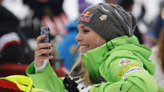 Lindsey Vonn, of the United States, looks at her phone in the finish area at the the women's World Cup downhill ski race in Lake Louise, Alberta, Friday, Nov. 30, 2012. (AP Photo/The Canadian Press, Jeff McIntosh)