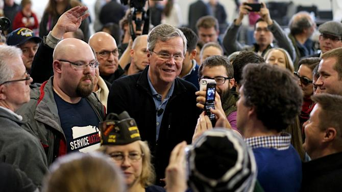 U.S. Republican presidential candidate Jeb Bush greets supporters after a campaign event in Bedford