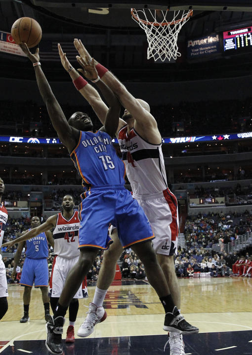 Oklahoma City Thunder guard Reggie Jackson (15) shoots over Washington Wizards center Marcin Gortat (4), from Poland, in the first half of an NBA basketball game on Saturday, Feb. 1, 2014, in Washingt