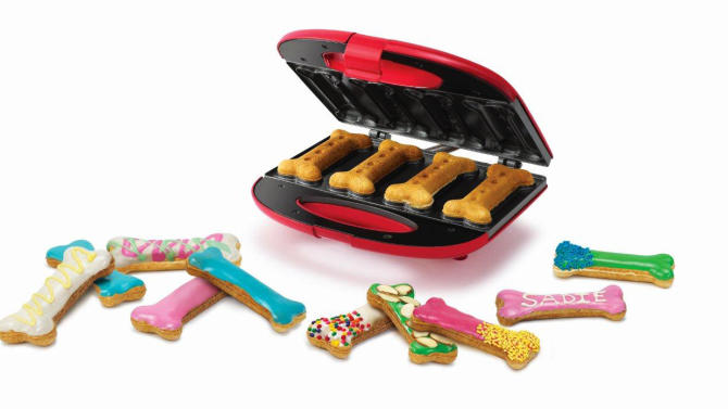 This undated photo provided by PetSmart shows a Sunbeam Holiday Dog Treat Maker, available at PetSmart Inc. stores. A holiday present for Fido or Fluffy used to be an extra table scrap or a new squeeze toy. But as with gifts for their human counterparts, pet presents are becoming increasingly high-tech. (AP Photo/PetSmart)