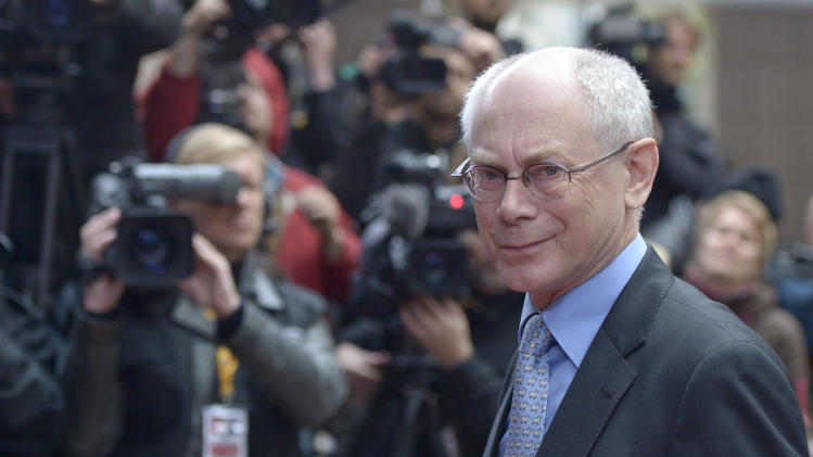 European Council President Herman Van Rompuy smiles as he faces the cameras upon arrival at an EU summit in Brussels on Wednesday, May 22, 2013.  Leaders from the 27 European Union countries gather in Brussels for one of their regular European Council sessions. On the agenda is the increasingly controversial subject of large corporations' creative tax avoidance schemes. (AP Photo/Ezequiel Scagnetti)