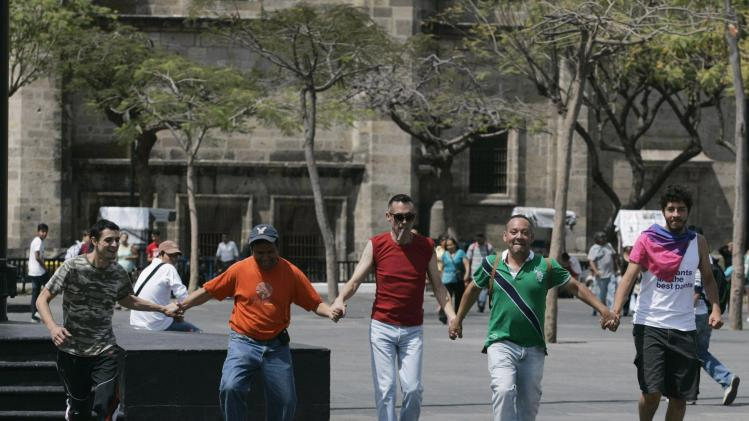 Men race wearing high heels during celebrations marking International Women's Day in Guadalajara