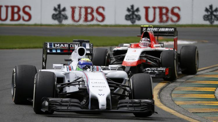 Williams Formula One driver Massa of Brazil drives ahead of Marussia Formula One driver Chilton of Britain during the third practice session of the Australian F1 Grand Prix in Melbourne