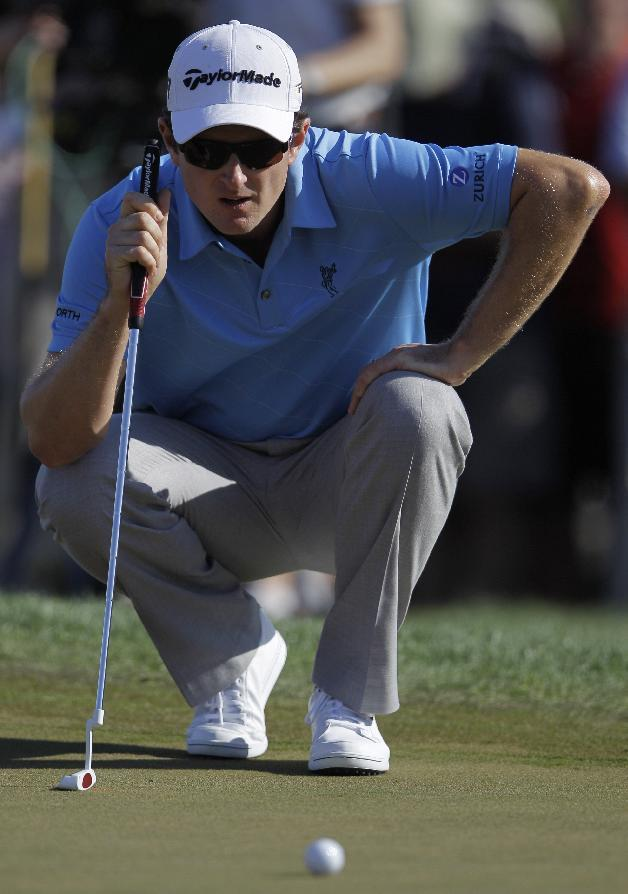 Justin Rose of England studies his play on the 10th hole during the third round of Abu Dhabi Golf Championship in Abu Dhabi, United Arab Emirates, Saturday, Jan. 19, 2013. (AP Photo/Kamran Jebreili)