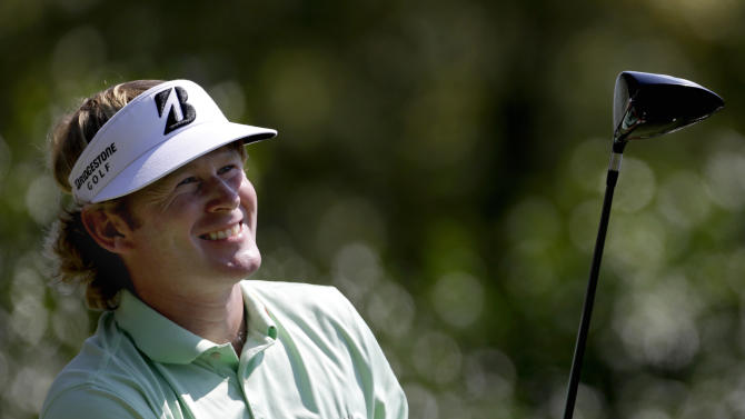 Brandt Snedeker watches his tee shoe on the third hole during the third round of the Tour Championship golf tournament Saturday, Sept. 22, 2012, in Atlanta. (AP Photo/David Goldman)