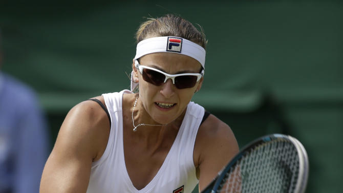 Yaroslava Shvedova of Kazakhstan returns a shot to Sara Errani of Italy during a third round women's singles match at the All England Lawn Tennis Championships at Wimbledon, England, Saturday, June 30, 2012. (AP Photo/Sang Tan)