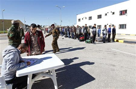 Men sign up for the Libyan army in Tripoli
