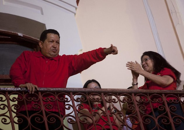 Venezuela's President Hugo Chavez greets his supporters from the Miraflores presidential palace balcony in Caracas, Venezuela, Sunday, Oct. 7, 2012. Chavez won re-election and a new endorsement of his socialist project Sunday, surviving his closest race yet after a bitter campaign against opposition candidate Henrique Capriles.(AP Photo/Rodrigo Abd)