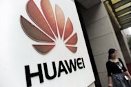 Chinese telecom firm Huawei's ambitions to become a global brand rivalling Apple and Samsung have been hit by a US report claiming that the company, founded by a former Chinese soldier, posed an espionage threat
