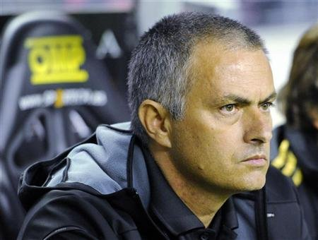 Real Madrid's coach Jose Mourinho reacts before the start of their Spanish first division soccer match against Athletic Bilbao at San Mames stadium in Bilbao