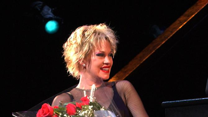 """FILE - In this July 20, 2003 file photo, Melanie Griffith takes a curtain call in the Broadway musical """"Chicago"""" at The Ambassador Theatre in New York. Griffith stars as Roxie Hart. The matinee performance on Aug. 27, 2011 will mark the musical's 6,138 show, meaning it vaults over """"A Chorus Line"""" to become the fourth longest-running show in Broadway history.  (AP Photo/Louis Lanzano, file)"""