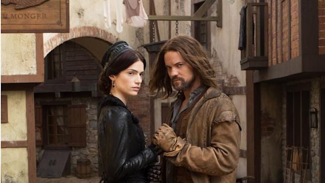 This photo provided by WGN America shows Janet Montgomery as Mary Sibley and Shane West as John Alden, in WGN America's ''Salem,'' premiering Sunday, April 20, 2014, (10pm ET, 9pm CT). Cable channel WGN America is adding original scripted programming to its schedule with the debut of the drama. (AP Photo/WGN America)