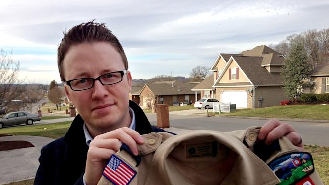 "FILE - In this Monday, Feb. 4, 2013 photo provided by the family, Wes Comer holds the Boy Scout uniform of his son, Isaiah, outside their home in Knoxville, Tenn. Comer, whose family attends an Apostolic Pentecostal church which considers homosexuality sinful, had been wrestling with whether to pull his eldest son out of the Scouts if the no-gays policy was abandoned. ""To be honest, I'm torn at this point,"" Comer said in an e-mail Friday, May 24, 2013. ""I'm not sure exactly what our decision will be."" ""If I place this situation in the context of my religious beliefs, I'm forced to ask myself, 'Would I turn a homosexual child away from Sunday School? From a church function? Would I forbid my children to be friends with a gay child?' I can't imagine a situation where I would answer 'yes' to any of those questions. So how can I in this one?"" he wrote. (AP Photo/Brooke Comer)"